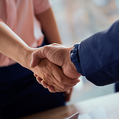 A man and woman shake hands