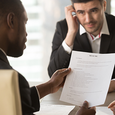 A man reviews a resume