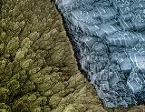 False color SEM image of warring CaCO3 polymorphs showing the transformation of vaterite (left) to the more stable calcite (right) on the surface of a hierarchical mineral tube grown from a gel-liquid interface.