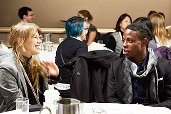Two attendees talk at the mentoring breakfast